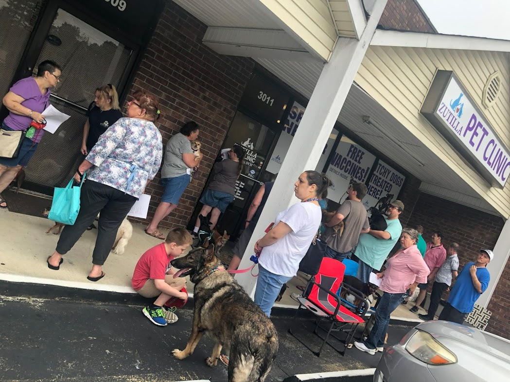 Pet owners waiting for event